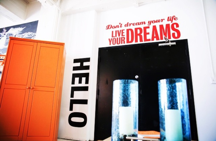 Our HELLO and Don't Dream Your Life Live Your Dreams wall decals in The Loft MixMatch House - an Airbnb in Los Angeles inspired by Etsy.