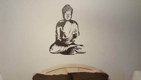 Our Buddha wall decal, shown here in dark brown, is a quick way to add wall art to any room.  Thank you to Steven for sharing a photo of his completed project.
