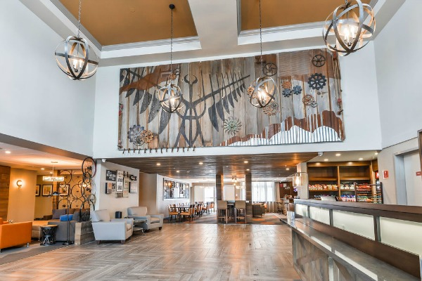 A commissioned art piece made from nearly 100% reclaimed products, showcasing things symbolic to the area. Interior design by Ritsick Design Associates.  Art designed by Wall Star Graphics. Photo credit:  Four Points Sheraton, Barrie ON Canada.