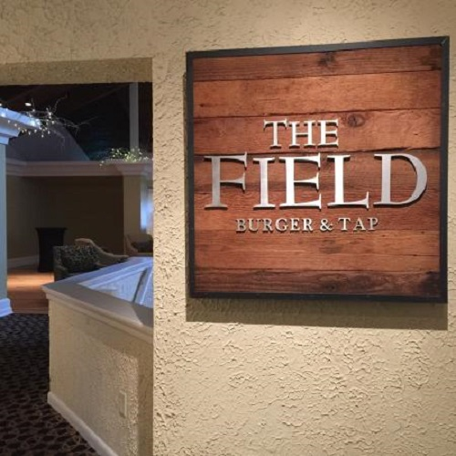 Designed and handmade by us using reclaimed barn wood. The Field Burger & Tap signage. Photo credit: The Field Burger & Tap - State College, PA
