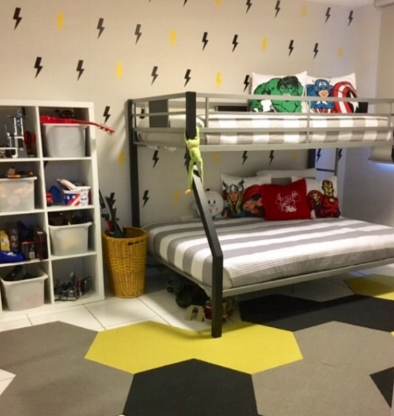 A fun super hero themed room featuring our lightning bolt wall decals in black and yellow. Photo credit: Jennifer Alvarez