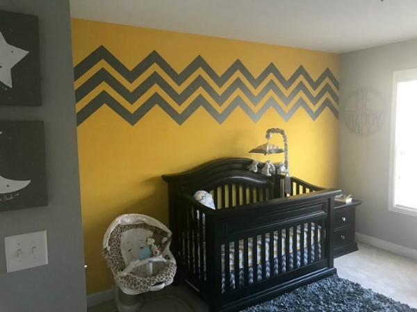 The nursery is now complete with our chevron wall decals shown in dark grey.  Photo courtesy of Jamiese M.
