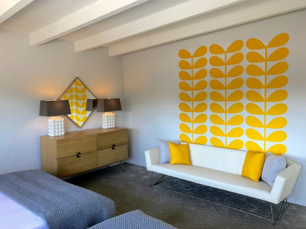 Hands down, we get to work with some of the greatest clients. This stunning bedroom from the Sunhaus Palm Springs vacation rental is complete, featuring our Retro inspired wall decals. (shown here in yellow) Photo credit: Jarrett Mason