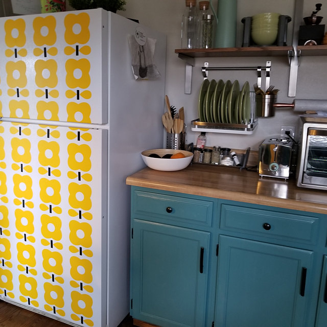 "Think wall decor is just for walls? Think again. One of our newest designs, in her own words, ""Made my very unattractive fridge unique."" Photo courtesy of Margo Ponce De Leon   Flowe  rs  in a two color option, shown here in Yellow and Black."