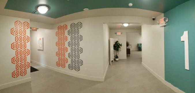 1ST FLOOR - Love the vision Inglese Architecture + Engineering used for the finishing touches on the Tennessee Green Luxury Apartments in Atlantic City, NJ. Our  fragmented hexagon wall decals  are shown here in orange and dark grey. Photo courtesy of Lynn Xanthos
