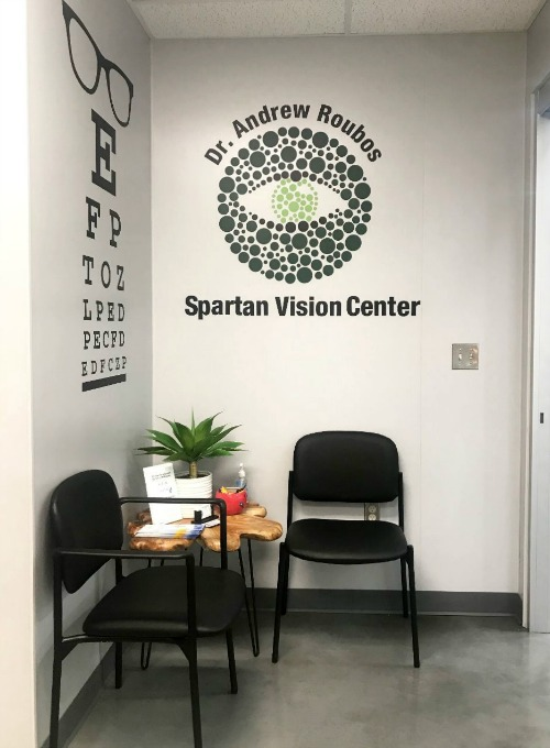 Thank you to Dr. Andrew Roubos for sharing this photo of his office, featuring our  Eye Chart  wall decal and his logo we made into a wall decal.