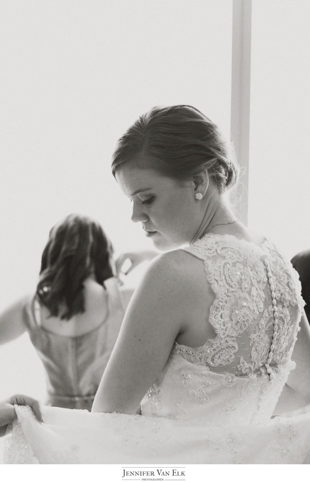 008 Bride getting in dress.jpg