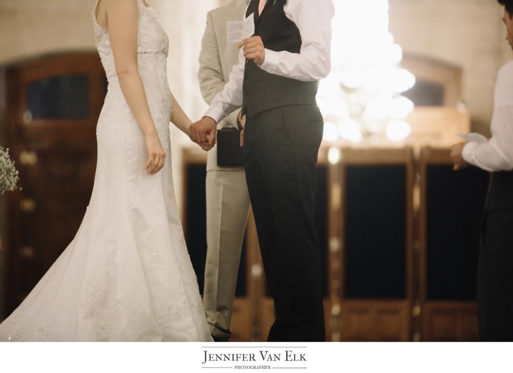 026 Bride and Groom holding hands.jpg