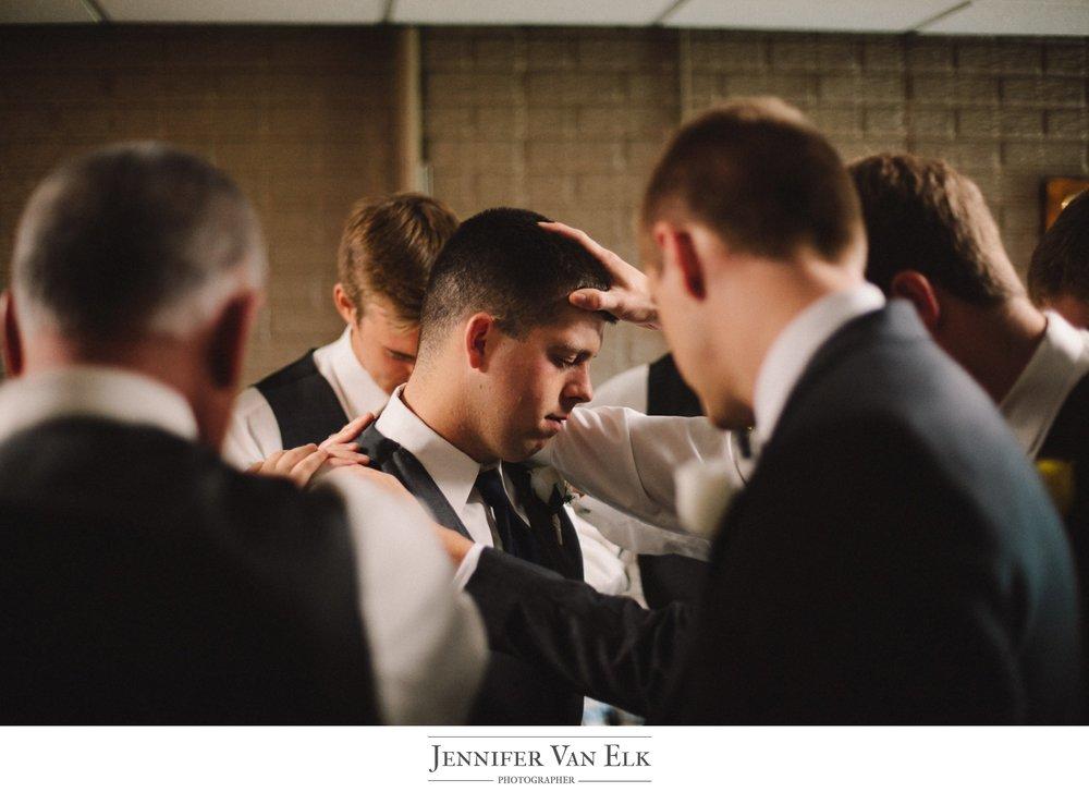 044 praying over groom.jpg