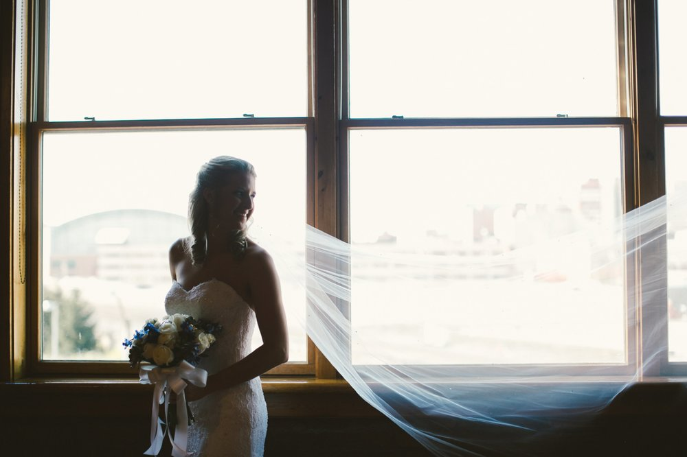the mavris_023 bride in window.jpg