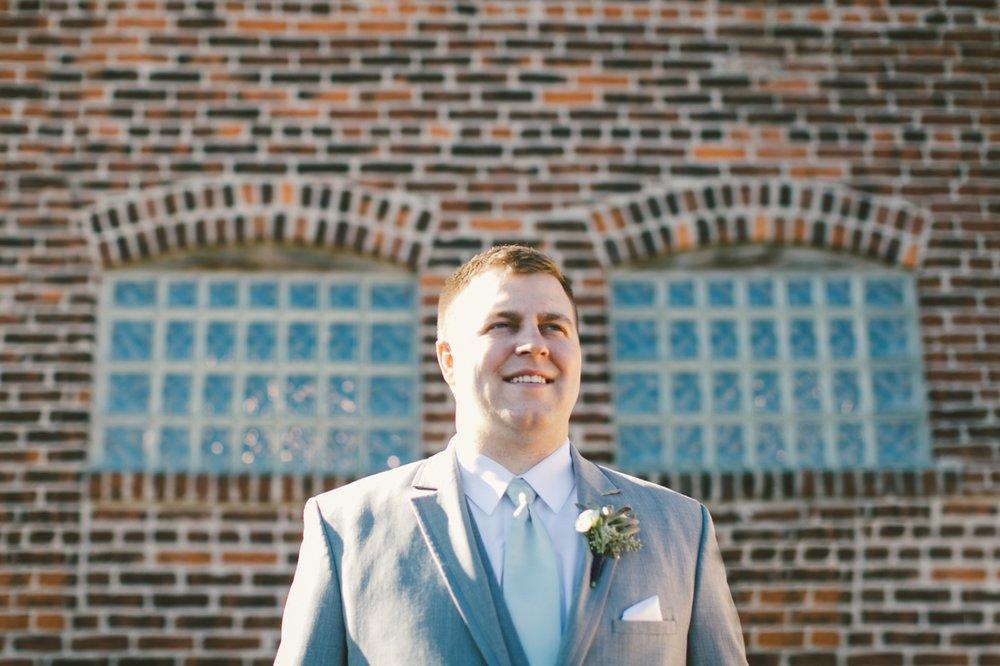 the mavris_033 groom outside.jpg
