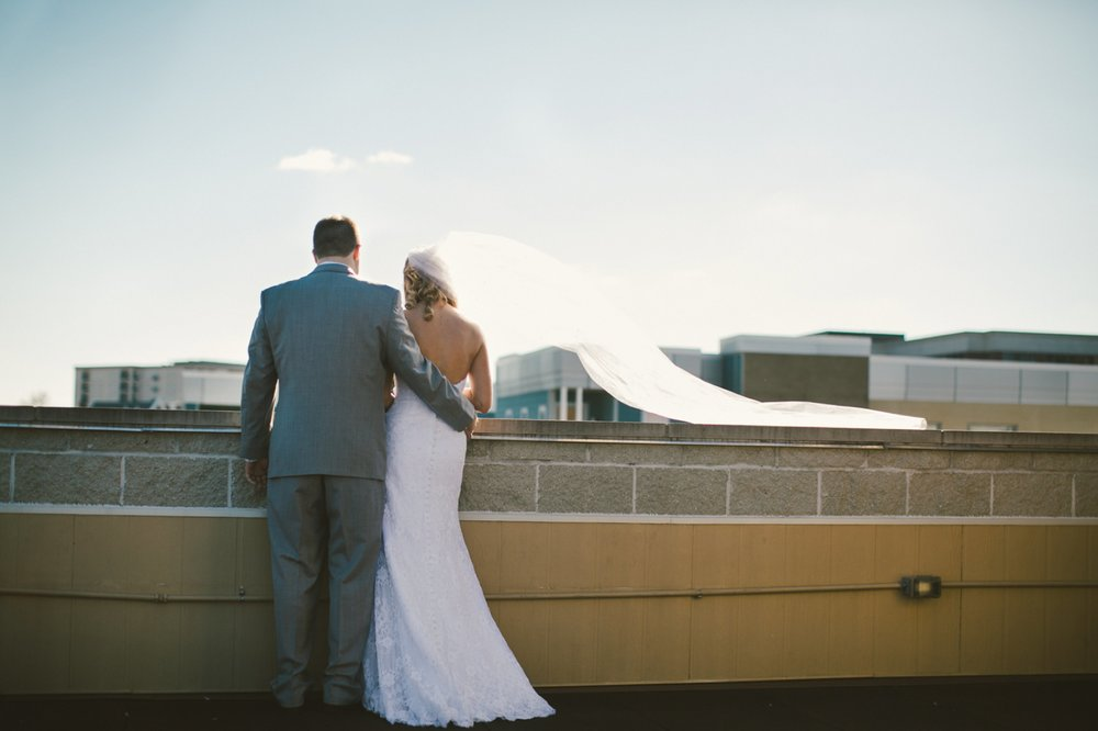 the mavris_034 bride and groom roof.jpg