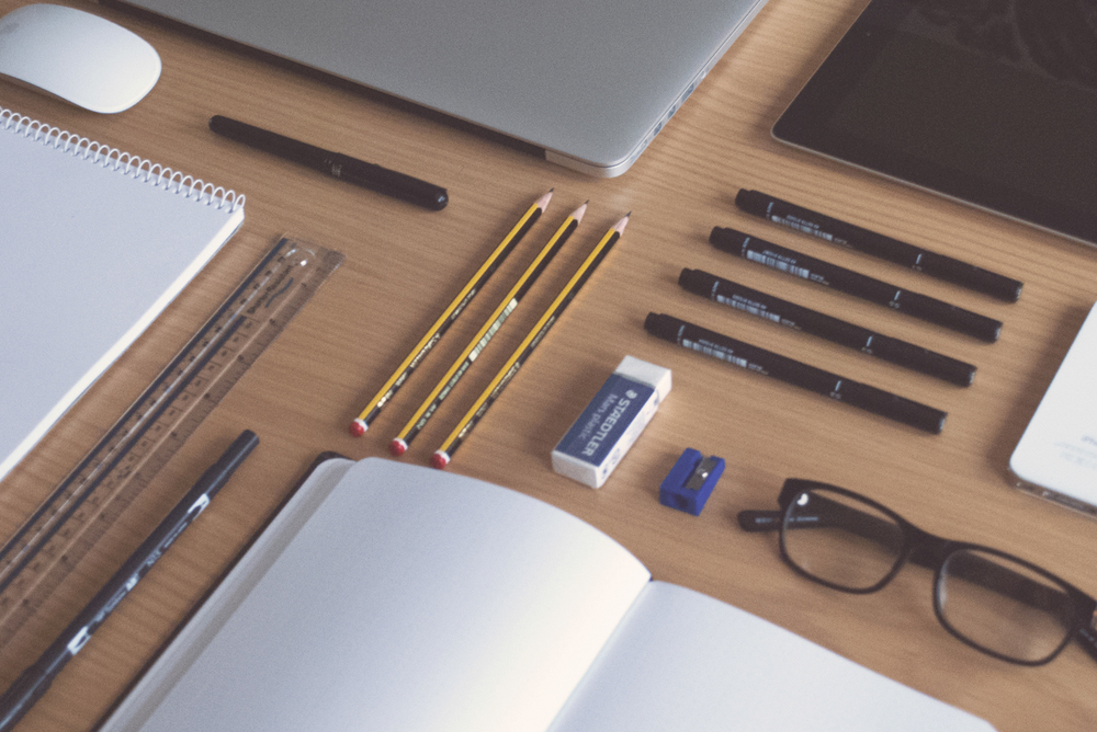 Orderly Desk with Pencils, Ruler, Notebook + Laptop
