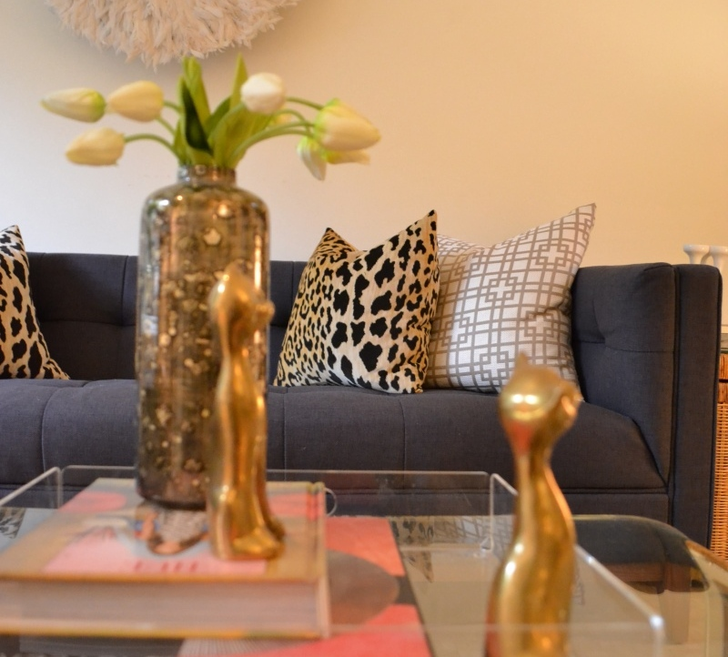 Having a bold pattern pillow  {like this leopard print design} in your room is just as important as accessorizing an beautiful black dress with pearls. This becomes very alluring in the home . Photo courtesy of Amy Kassam Design Firm.