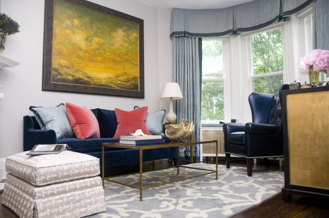 My designer color crush of the moment is Strawberry Pink & Marine Blue. Note how the design colors and shape, especially the Strawberry Pink make the velvet blue couch a warm and inviting focal point for this room. Strawberry Pink and the Marine Blue both can be statement colors on their own, but work well in tandem, complimenting each other.  This room is designed by one of my favorites, Zoe Feldman.