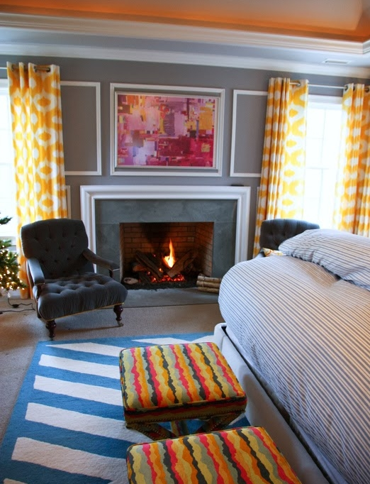 Vivid Hue Home has made my heart swoon with their choice of color. It would be interesting to find out whether the ottoman fabric or the painting was the inspiration for this project. The slate blue notes in the accent chair and fireplace are marvelous complimentary tones. This entire home tour is amazing!