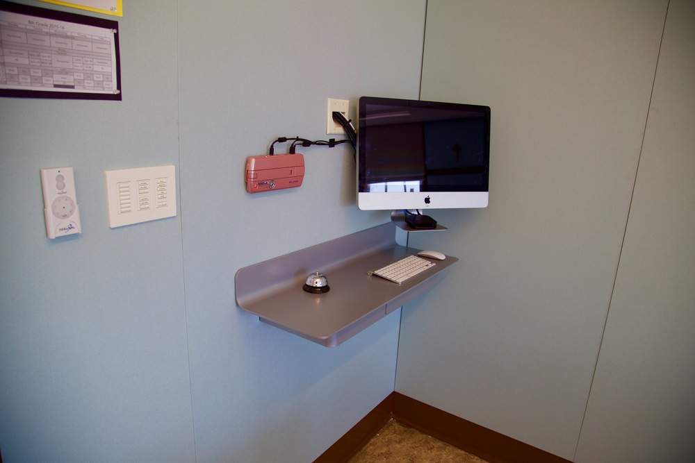 Wall mounted instructor workstations