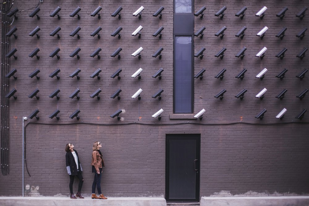 Image Of Security Cameras Looking At People.jpg