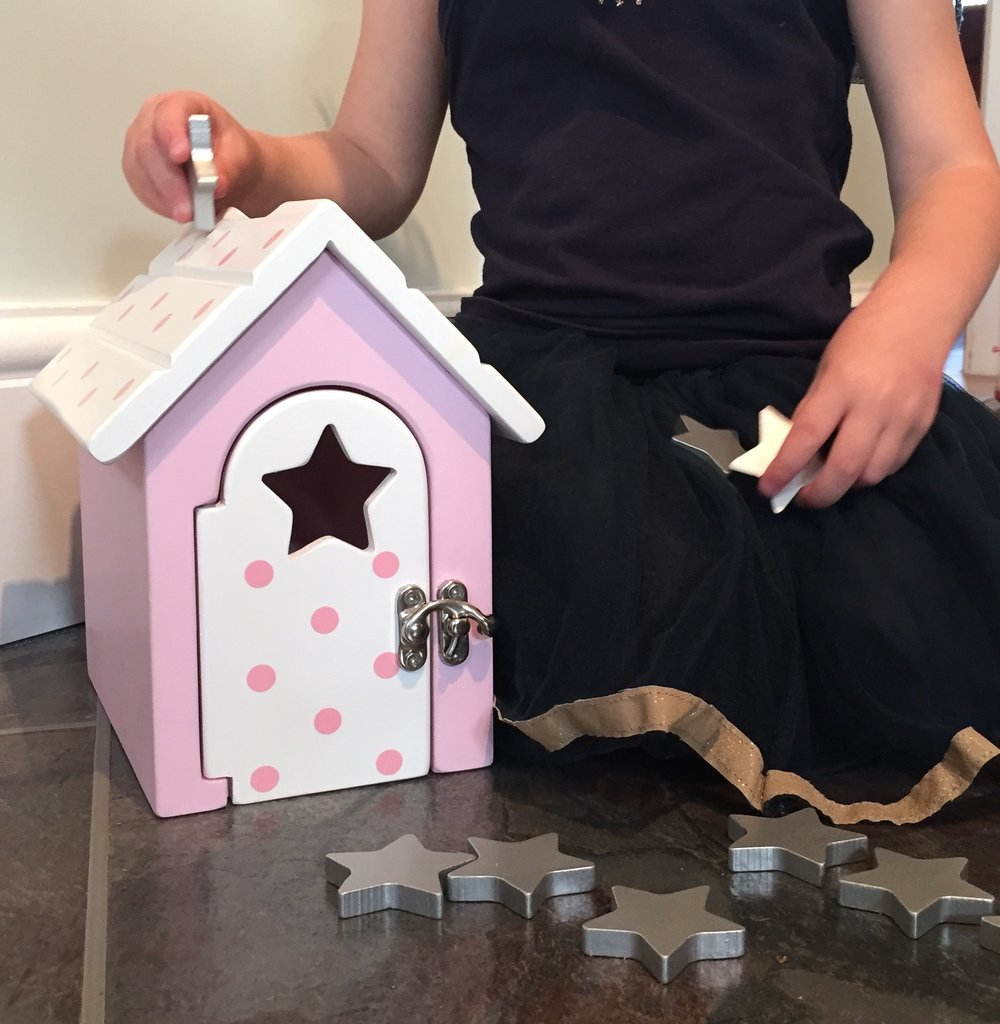 Girl in tutu playing with Fairy Reward Box.jpg
