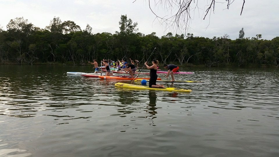 SUPs kneeling in readiness for start of race