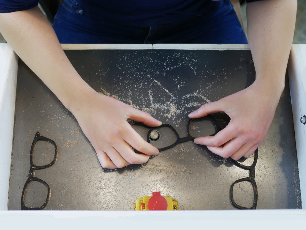 04.Lucy-Hand-cutting-lens-grooves-in-the-studio-workshop.jpg