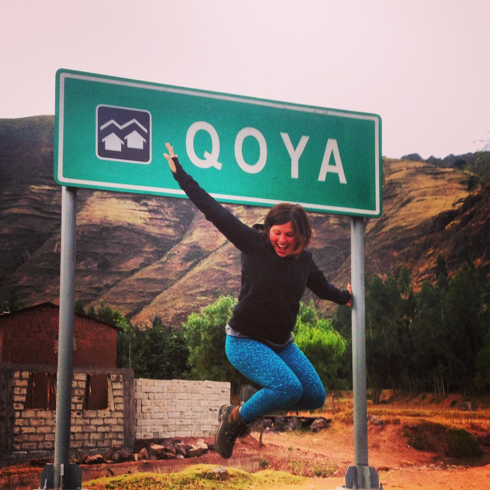 Unexpectedly, driving through the sacred valley of Peru, they passed a town called Qoya! Rochelle jumped out of the bus and into the frame for a quick photo.