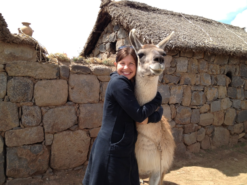 A little llama love can go a long way.  Lake Titicaca, Peru
