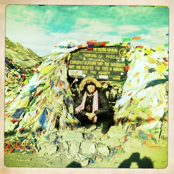 Rochelle at the summit of Thorong La Pass in the Himalayas at 5416 meters, 17769 feet
