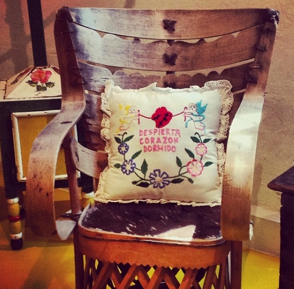 "This pillow in Frida Kahlo's home became a mantra for Heart Opening in Qoya: ""Wake up, sleepy heart!"""