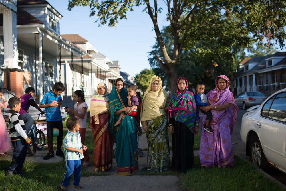 A group of women pose for a portrait outside of there homes on Eid in Detroit, Michigan.