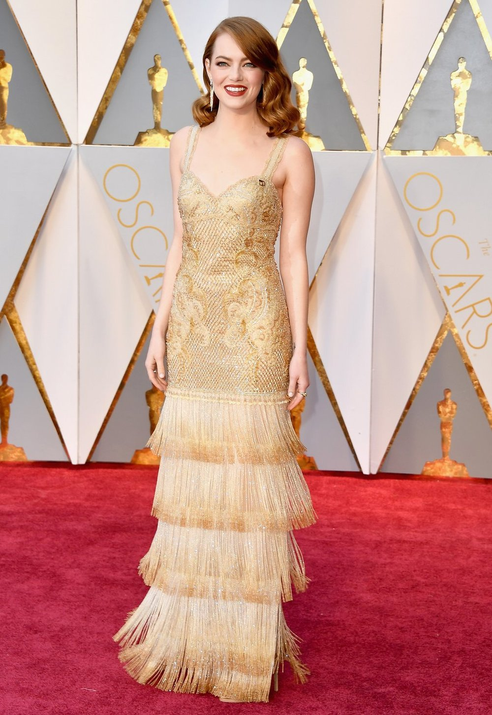 Emma Stone nailed red-carpet dressing, as per usual, in this delightful, golden Givenchy dress.jpg