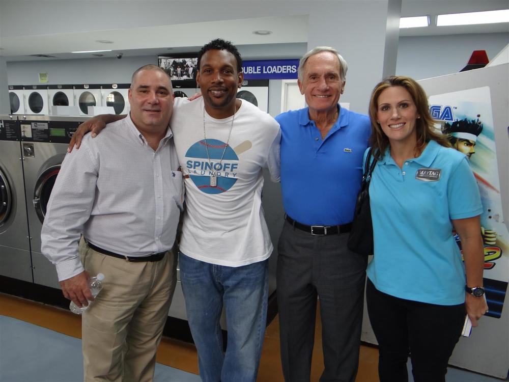 Greg Paci, sales representative for Equipment Marketers; Ernest (Bo) Donaldson, owner of Spin Off Laundry; Dick LaMaina, president of Equipment Marketers; and Katie Weitzman, assistant vice president of Equipment Marketers, celebrate the recent grand opening of Spin Off Laundry. (Photo: Maytag Commercial Laundry)