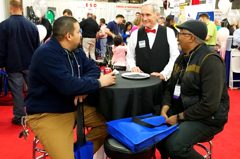Dick Lamaina, President of Equipment Marketers, speaking with customers.