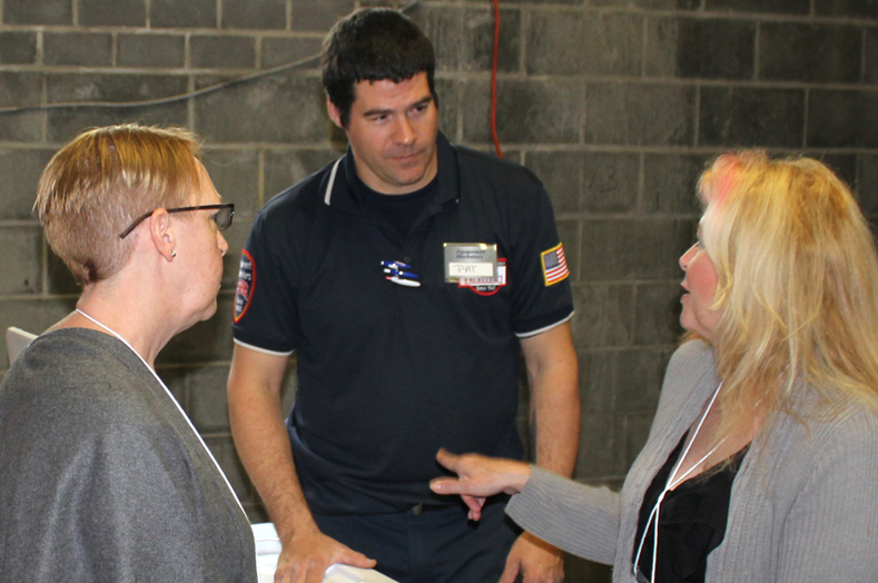 Serrvice technician Pat Hagan answering customers question regarding customer service at Equipment Marketers.