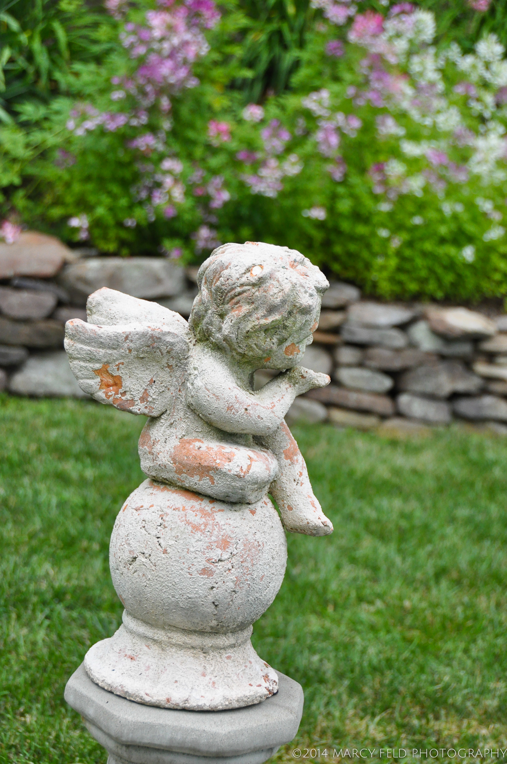 Sweet little cherub which was the first purchase after the pool installation