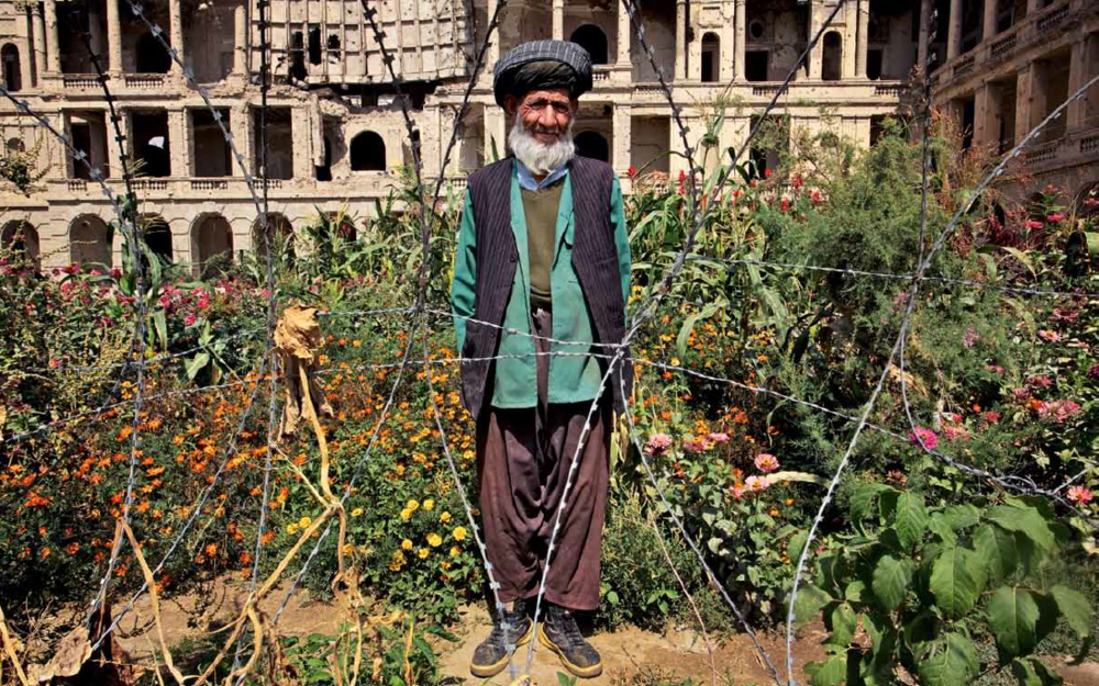 Mohammad Kabir (age 105) posing in front of his garden at Darul Aman Palace, which translates as 'abode of peace'; in Kabul, Afganistan. Photo credits to Lalage Snow.