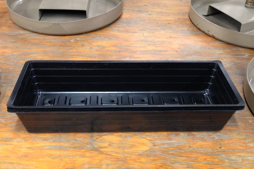 "Seeding tray: 3"" x 4""x 18"" perforated plastic tray."