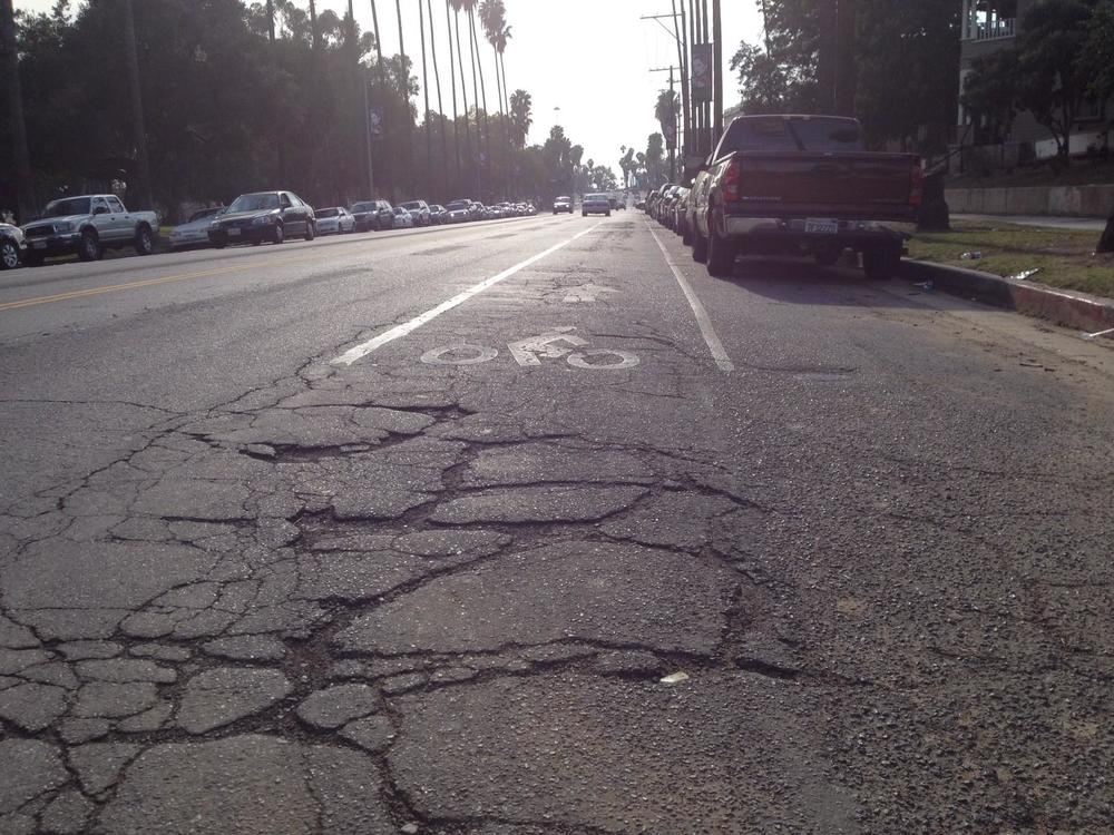 Cycling on the edge: Dodging cars and bike lane potholes, LA Times, 26 February 2014