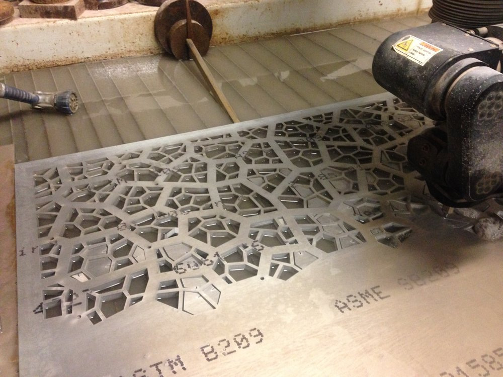 Waterjet cutting the pattern from solid aluminum.