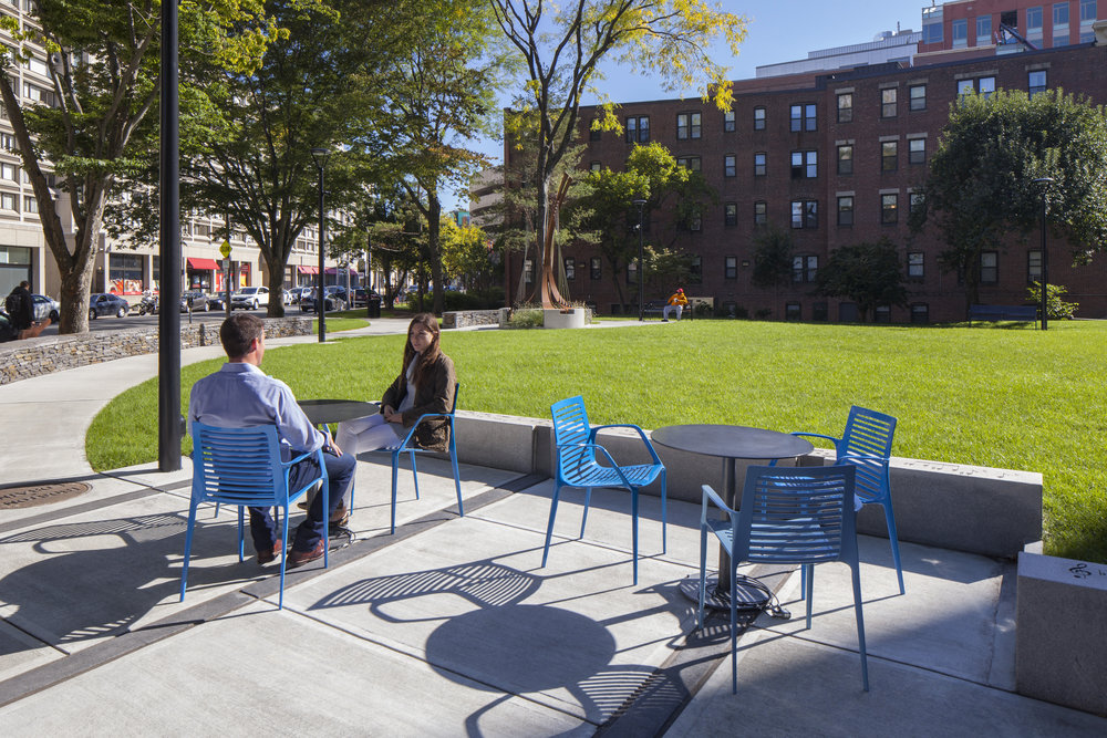 At Symphony Park, we designed this gathering space for everyday casual gatherings and the occasional concert or chair yoga class. It was sized to be comfortable with just two people or up to thirty people with movable furniture to allow for the difference uses.