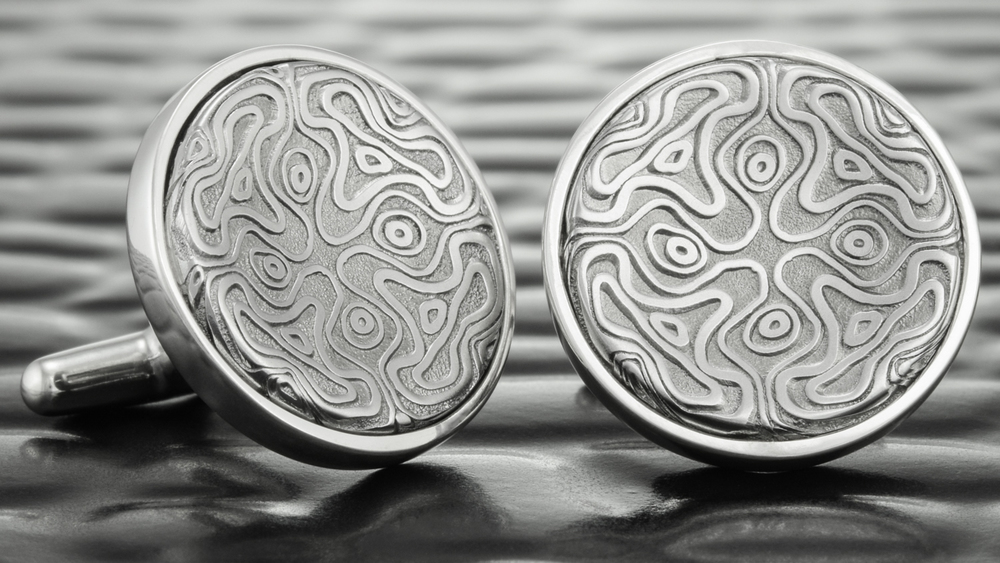 A matching pair of custom cufflinks for the groom.
