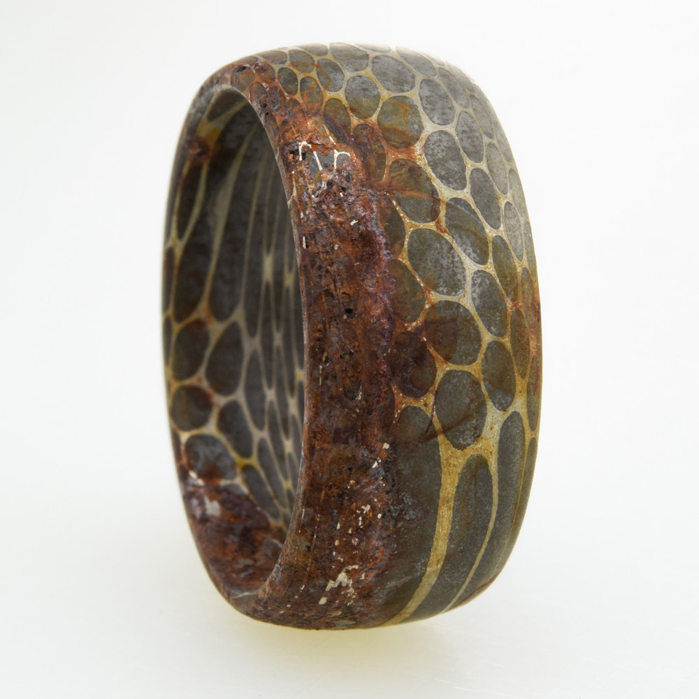 Rust on a Damascus Steel ring. The quality of the stainless steel used is the most important factor.