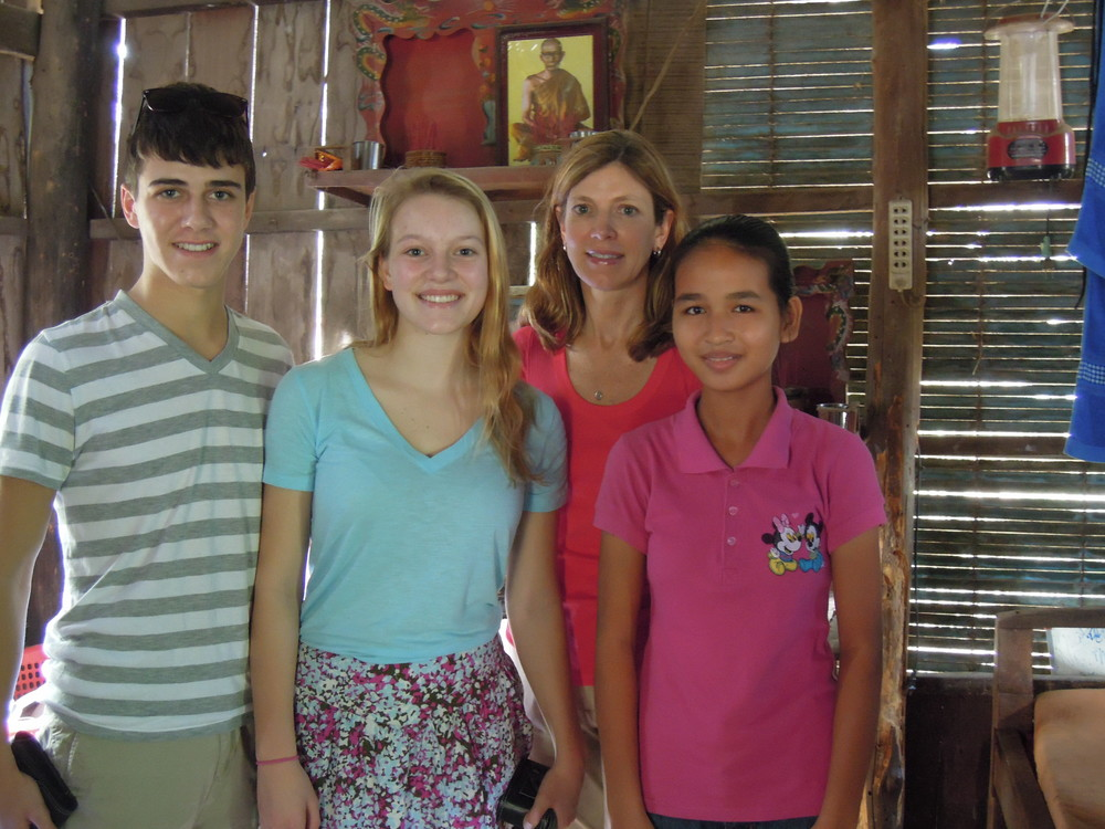 Cody and Kristina Hall, Melinda LeClercq visit their student in Phnom Penh.