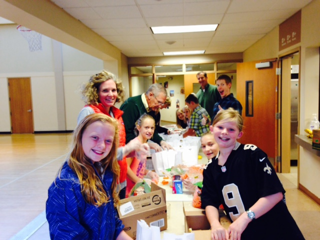 Preparing brown bag lunches for our mission partner, Plymouth on Stewart.