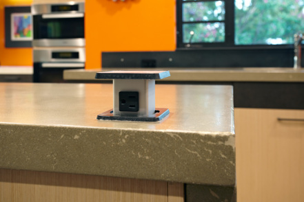 Pop-Up Outlet on Concrete Countertops. Photo by PhotographerLink