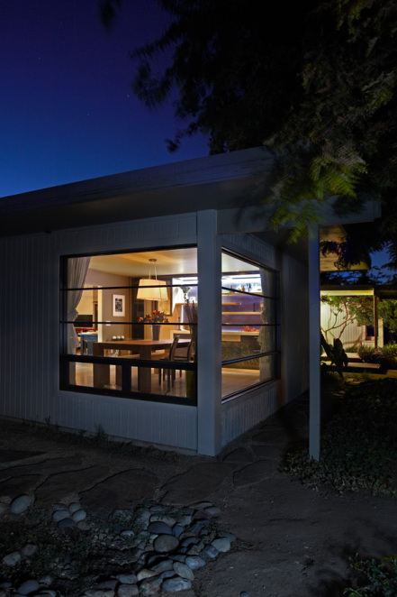 Exterior Dining Room View- Custom Aluminum Windows. Photo by PhotographerLink