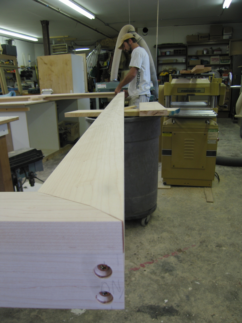 We made a custom jig to shape the chamfered profile of the frame.