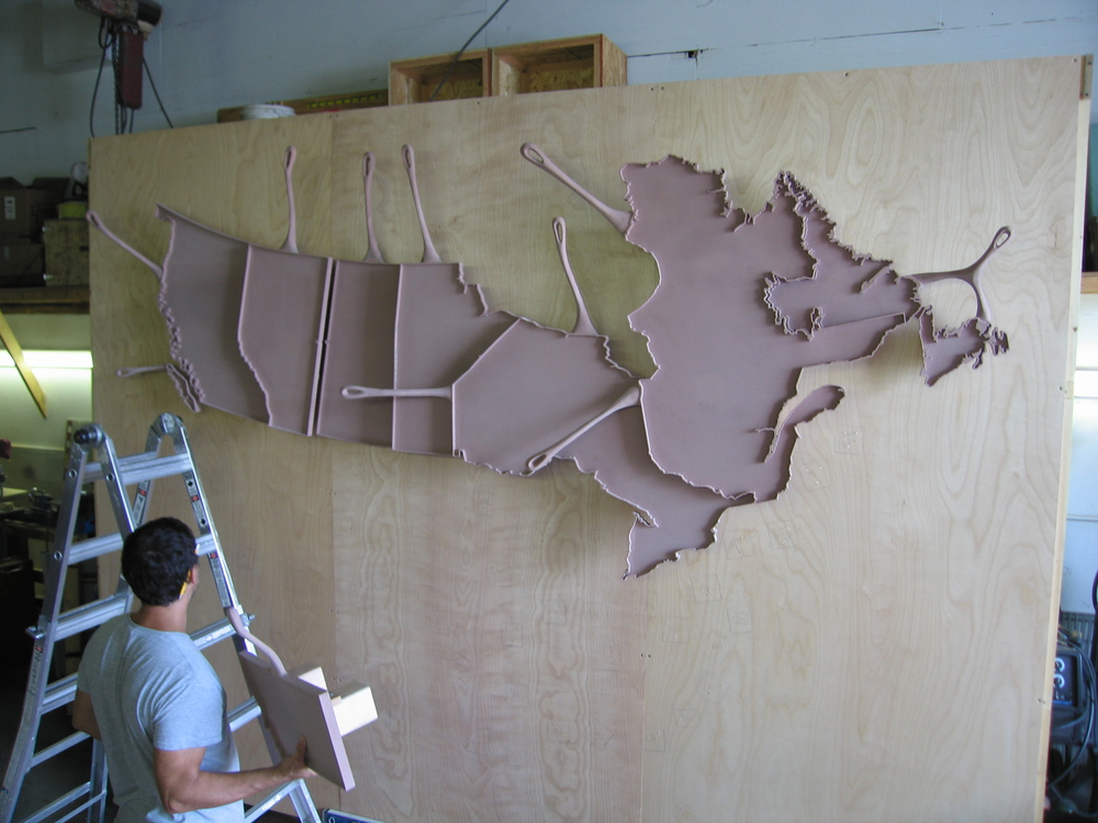 Help from our friend and local artist Aaron Laux, we needed 3 sets of hands and eyes to put up Canada first.