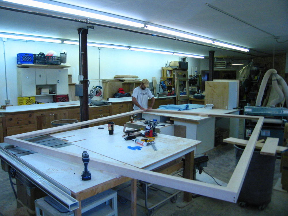 This is the other room where Andrew starts on the Maple wood frame that fits around the finished piece. Again, taking up nearly the whole room with this huge frame !