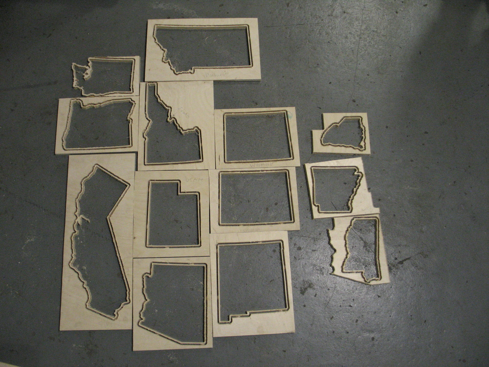 This is what the states look like after they're done on the mill. Just rough outlines at this point, no bottom boards or handles yet.